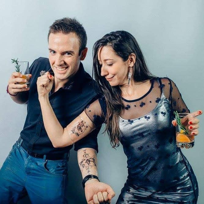 Simo and I posing our recently made twin tattoos on the arms